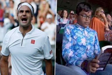 Roger Federer Vs Rafael Nadal Semi-Final: Indian Origin Boy Seen Engrossed in His Book During Wimbledon 2019 Clash of Tennis